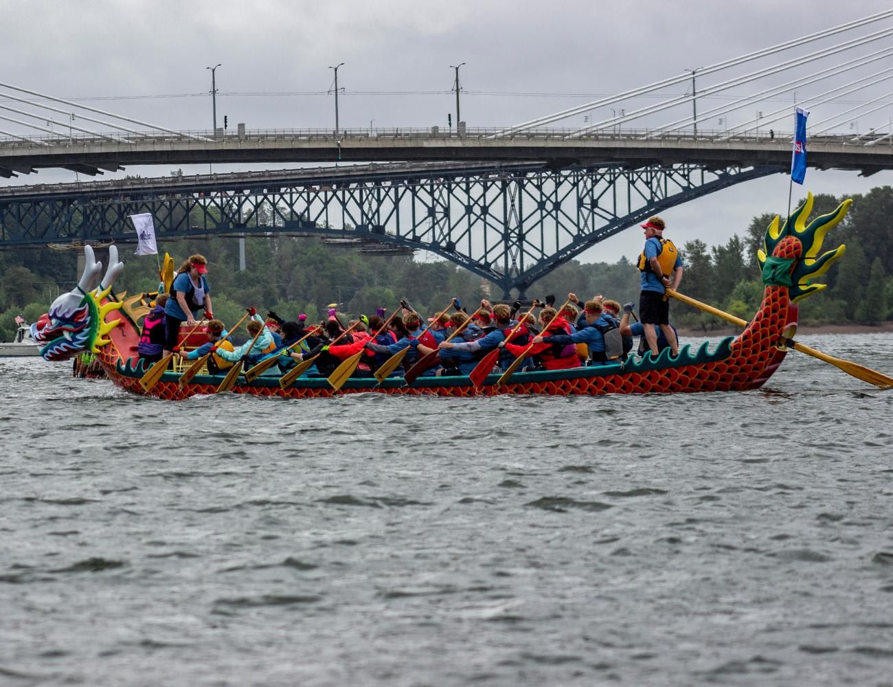 Hundreds of people filled Tom McCall Waterfront Park on Sunday, June 10, 2018 for the Portland Rose Festival Dragon Boat Races. The annual cultural event is hosted by the Portland-Kaohsiung Sister City Association. It features dozens of dragon boat teams from around the world who race in Taiwan-style dragon boats down the Willamette River. Photo by Amanda Butt