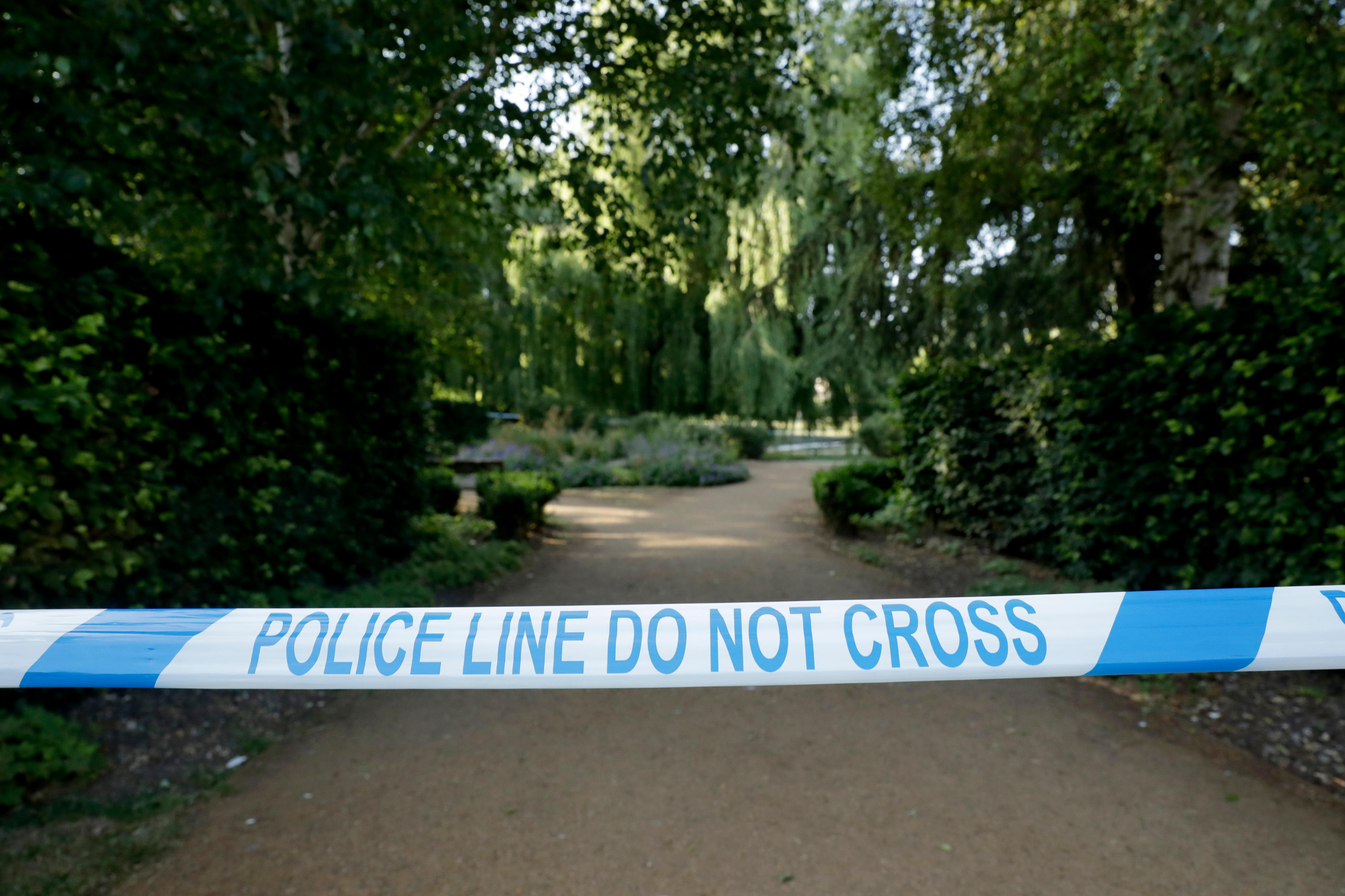 Police cordon tape hangs surrounding the Queen Elizabeth Gardens park in Salisbury, England, Thursday, July 5, 2018. British officials are seeking clues Thursday in the rush to understand how two Britons were exposed to the military-grade nerve agent Novichok. (AP Photo/Matt Dunham)