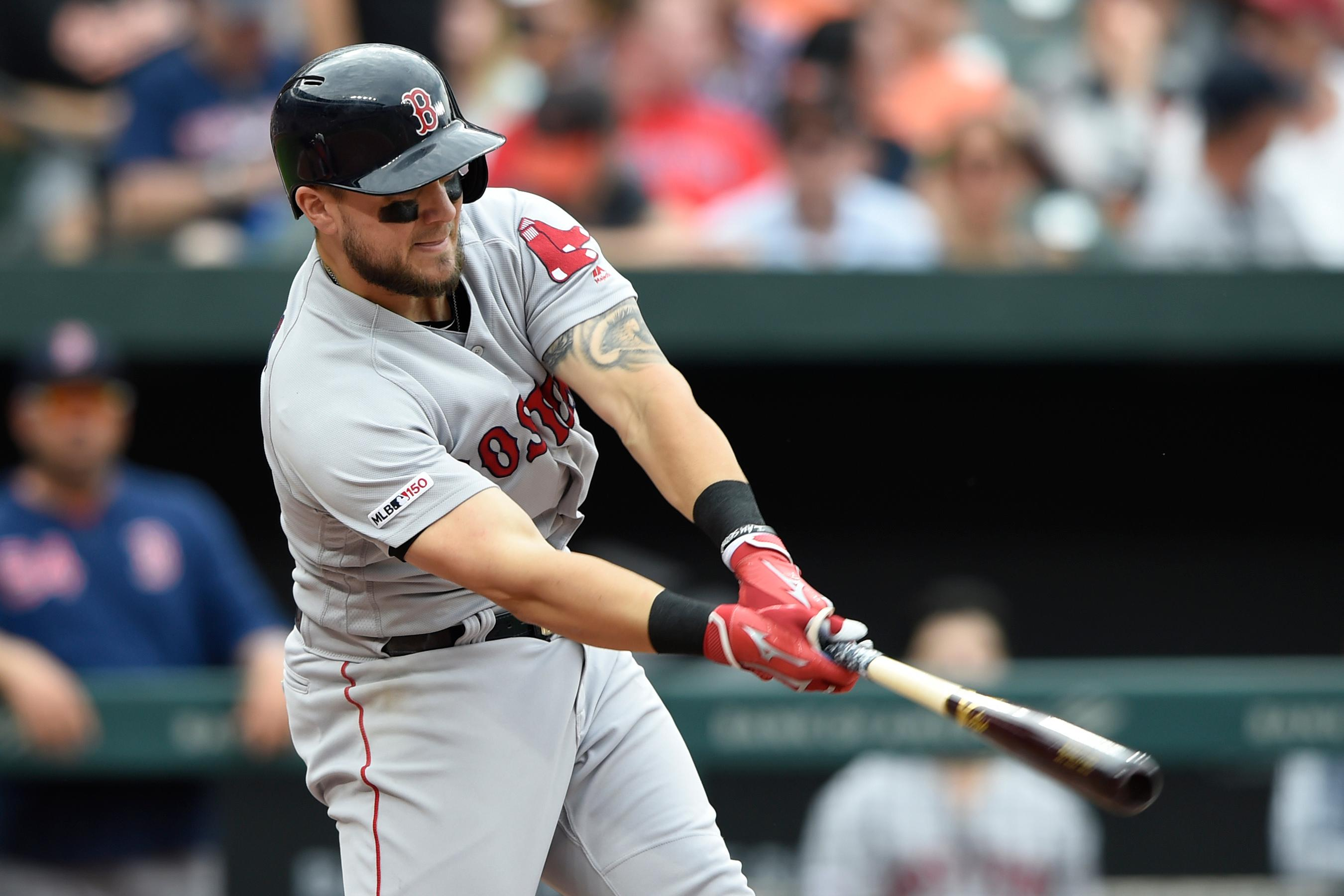 Boston Red Sox's Michael Chavis hits a single against the Baltimore Orioles in the sixth inning of a baseball game Saturday, June 15, 2019, in Baltimore. (AP Photo/Gail Burton)