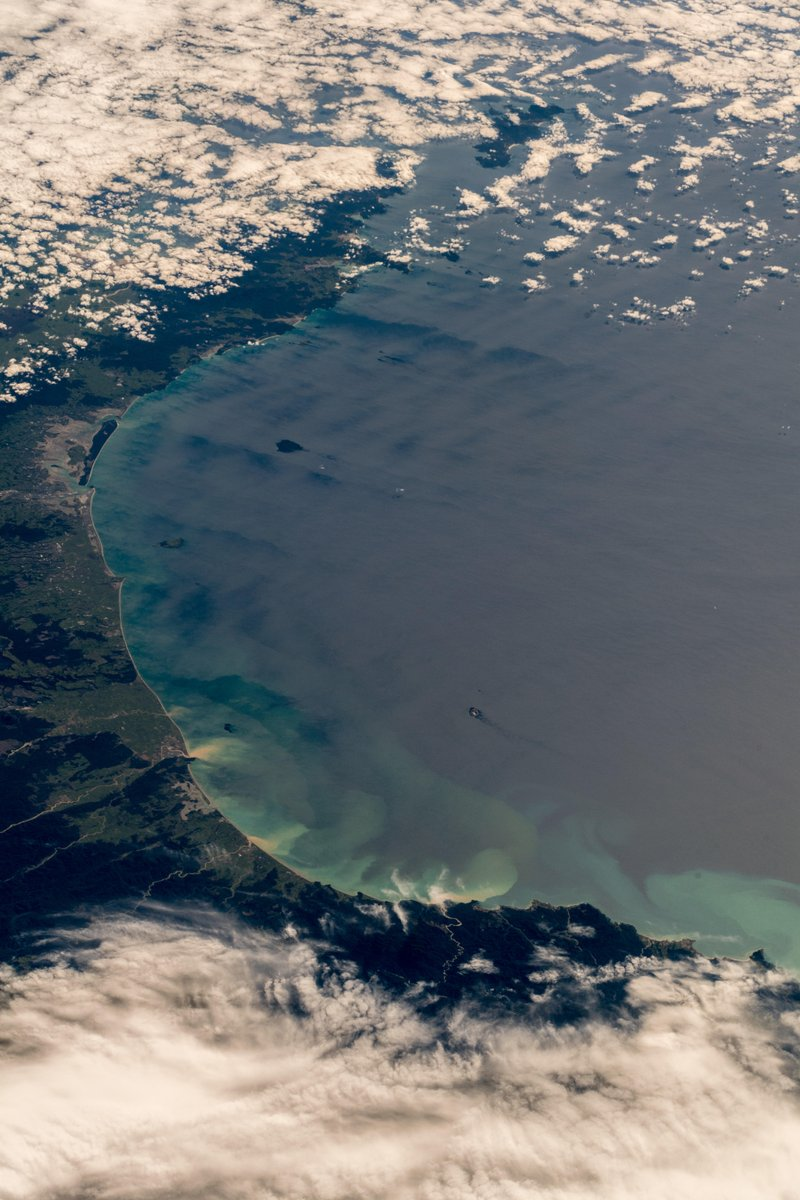 The beautiful Bay of Plenty in New Zealand, framing its smoking White Island volcano. I miss scrambling around on volcanoes (Photo & Caption Alexander Gerst, NASA)