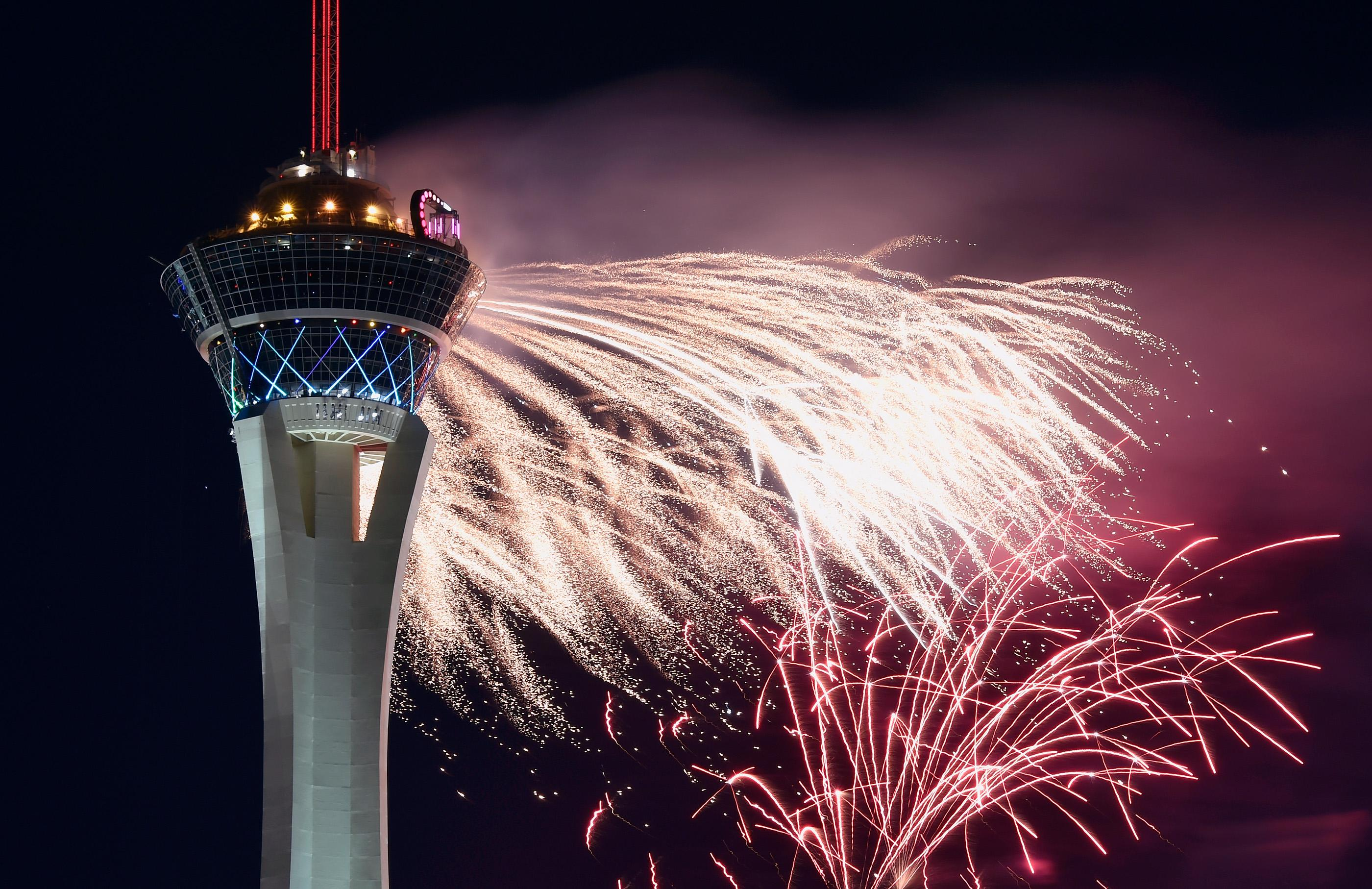 Fireworks light up the sky at the Stratosphere Tower in celebration of the Independence Day holiday Wednesday, July 4, 2018, in Las Vegas. Hotels across the Las Vegas valley launch a bevy of firework displays in honor of the United States' 242nd birthday. CREDIT: David Becker/Las Vegas News Bureau