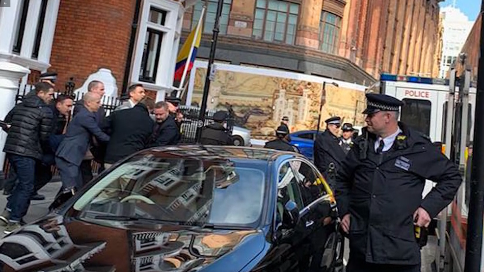 Julian Assange is dragged out of the Ecuadorian embassy in London by British police on Apr. 11, 2019. (Adrian Cotterill/CNN Newsource)