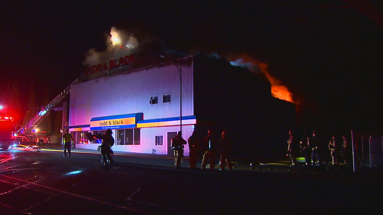 On Saturday, fire crews were back on scene after responding to a massive fire at an Everett appliance store Friday evening. (Photo: KOMO News)
