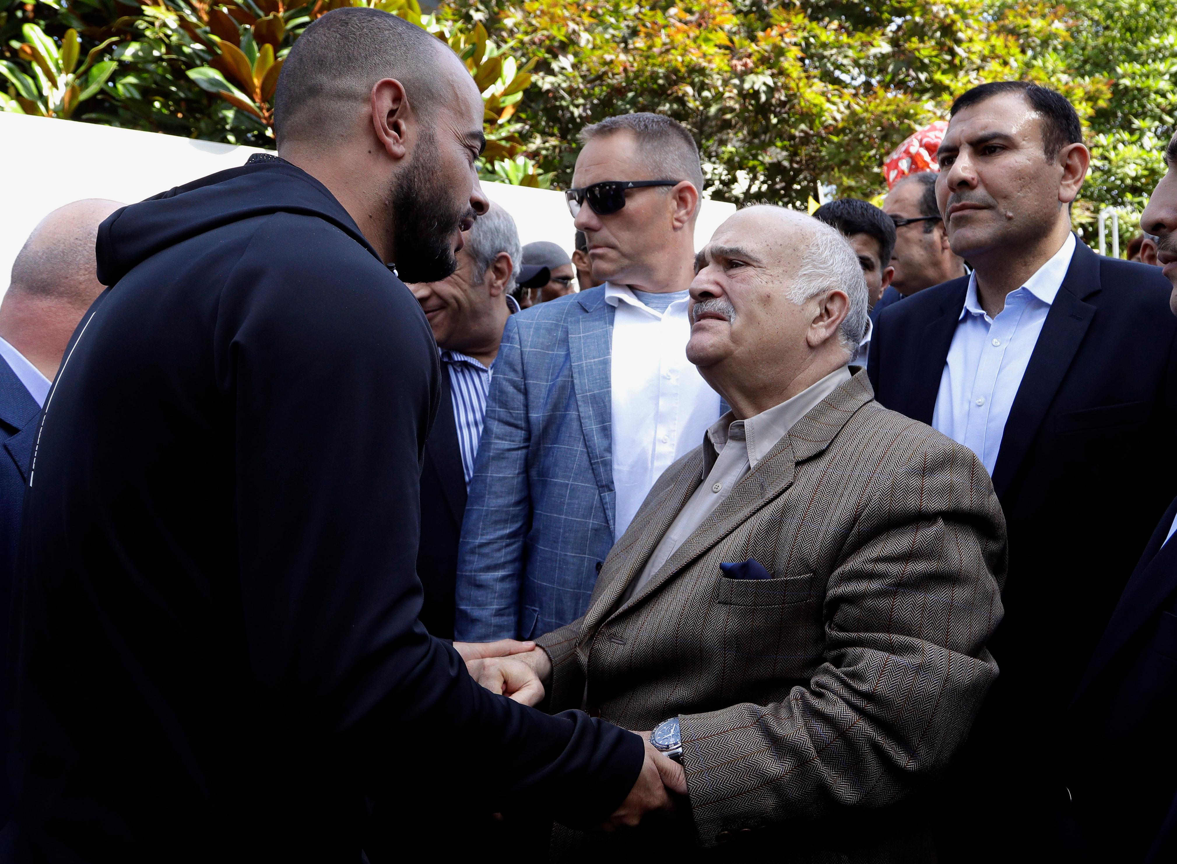 His Royal Highness Prince El Hassan bin Talal Hashemite, second right, of the Kingdom of Jordan greets a worshipper outside the Al Noor mosque in Christchurch, New Zealand, Saturday, March 23, 2019. The mosque reopened today following the March 15 mass shooting. (AP Photo/Mark Baker)