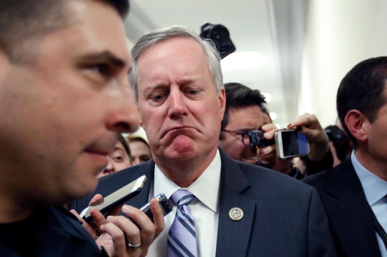 House Freedom Caucus Chairman Rep. Mark Meadows, R-N.C. reacts to a reporters question on Capitol Hill in Washington, Thursday, March 23, 2017, following a Freedom Caucus meeting. (AP Photo/Alex Brandon)