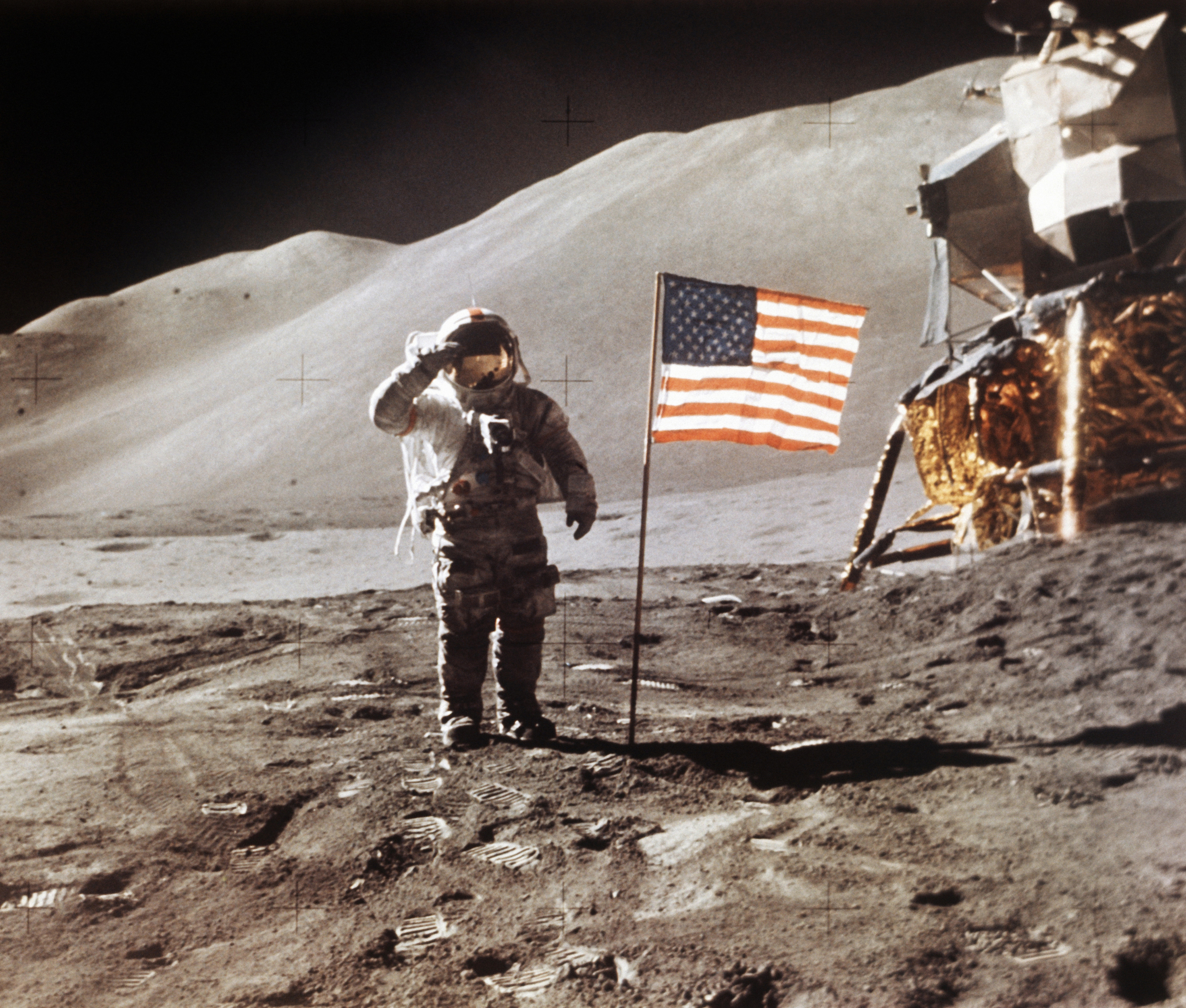 FILE - In this July 30, 1971 photo made available by NASA, Apollo 15 Lunar Module Pilot James B. Irwin salutes while standing beside the fourth American flag planted on the surface of the moon. (NASA via AP)