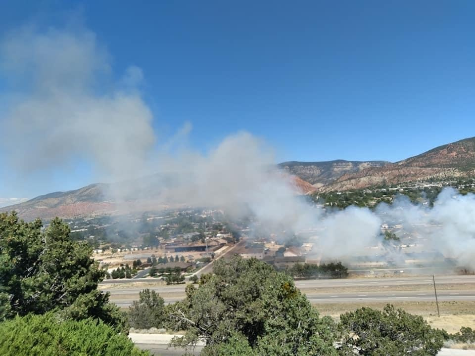 Brush fire ignites power pole, lines in Cedar City.{ }(Michael J. Craft)