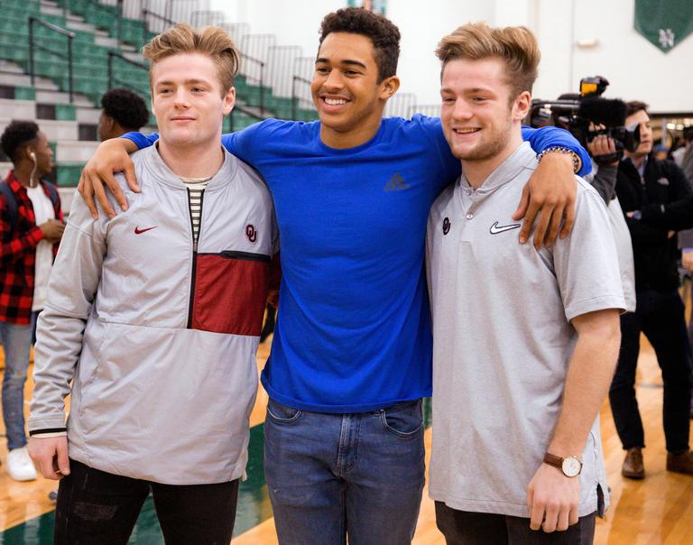 Norman North's Ryan Peoples, center, poses for a photo with Drake, left, and Issac Stoops, after signing his letter of intent to play football for Northeastern Oklahoma University during national signing day at Norman North High School in Norman, Okla., Wednesday, Feb. 7, 2018. The Stoops brothers, twin sons of former Oklahoma head coach Bob Stoops, will be preferred walk-ons to play football for the University of Oklahoma. (Chris Landsberger/The Oklahoman via AP)<p></p>