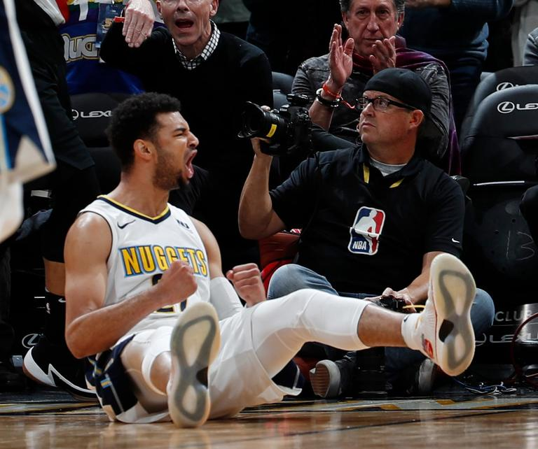 Denver Nuggets guard Jamal Murray reacts as he falls to the court after hitting the tying basket and drawing a foul shot against the Portland Trail Blazers late in the second half of an NBA basketball game Monday, Jan. 22, 2018, in Denver. The Nuggets 104-101. (AP Photo/David Zalubowski)