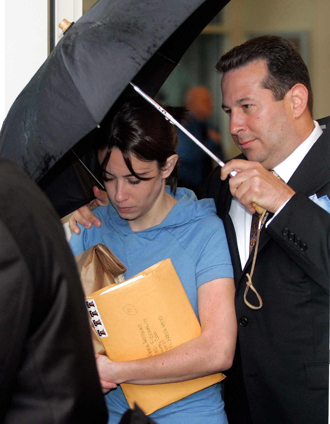 FILE- In this Aug. 21, 2008, file photo, Casey Anthony, mother of missing toddler Caylee, is escorted from the Orange County Florida jail by her attorney Jose Baez. (AP Photo/Reinhold Matay, File)