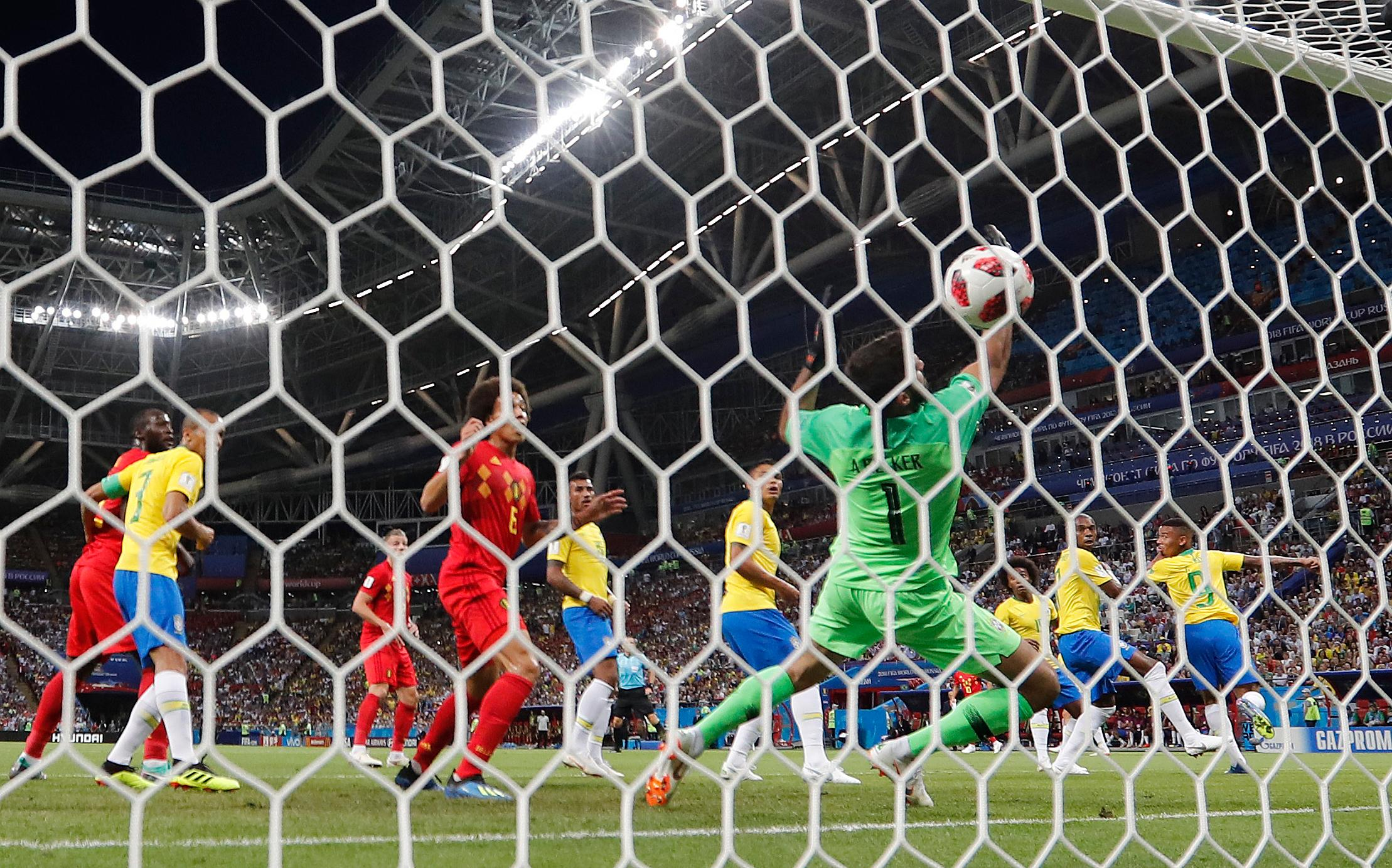 Brazil's Fernandinho, second right, scores an own goal past Brazil goalkeeper Alisson during the quarterfinal match between Brazil and Belgium at the 2018 soccer World Cup in the Kazan Arena, in Kazan, Russia, Friday, July 6, 2018. (AP Photo/Frank Augstein)