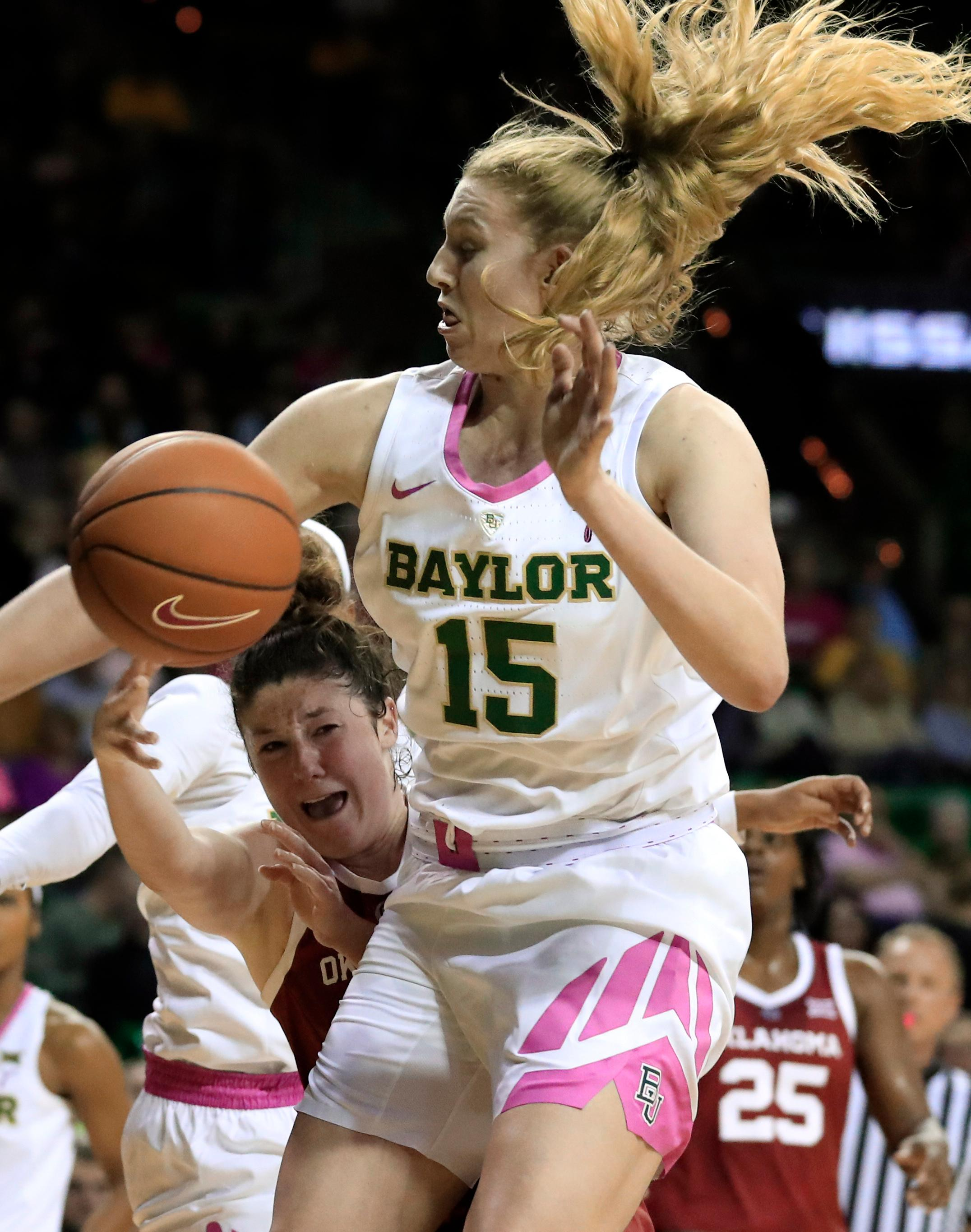 Oklahoma guard Jessi Murcer, left, passes the ball as Baylor forward Lauren Cox (15) defends during the first half of an NCAA college basketball game in Waco, Texas, Saturday, Feb. 16, 2019. (AP Photo/Tony Gutierrez)