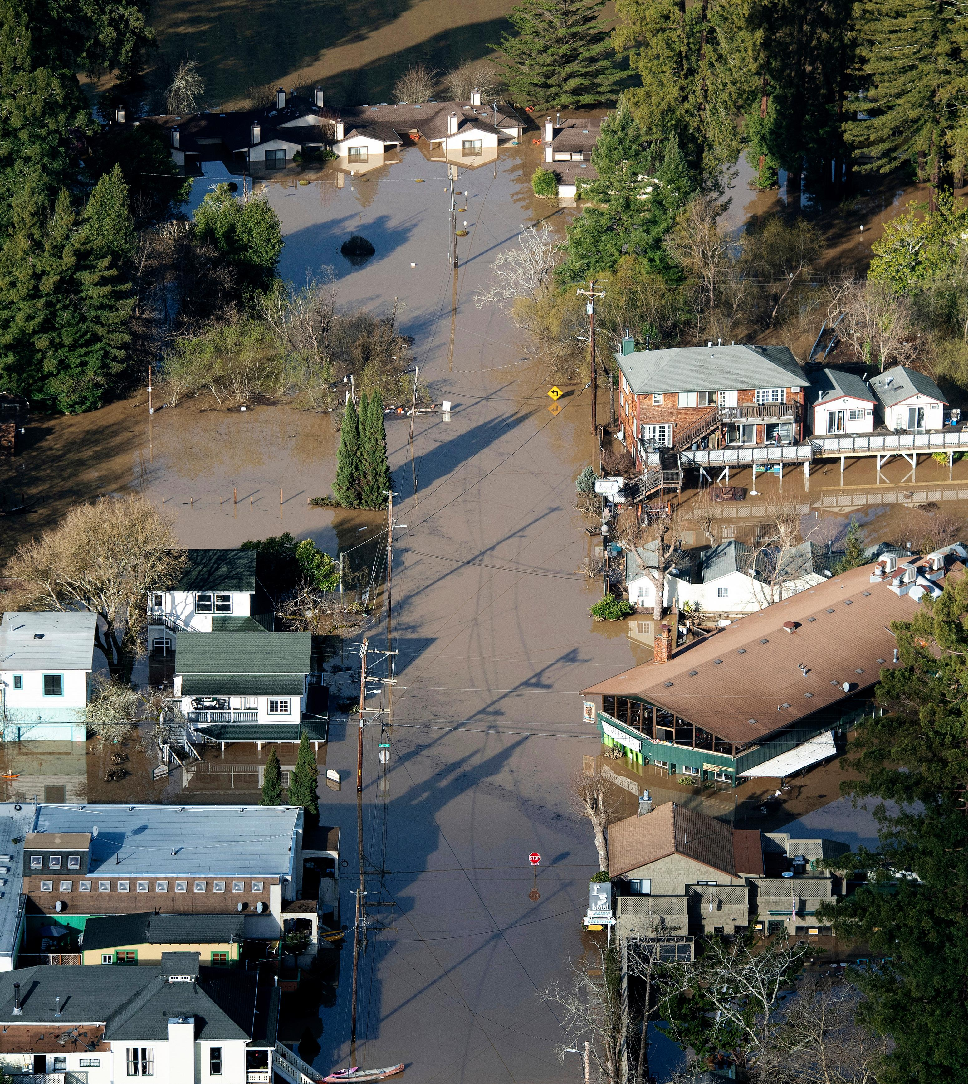 Flood waters from the Russian River partially submerge properties in Guerneville, Calif., on Thursday, Feb. 28, 2019. The river in the wine country north of San Francisco reached its highest level in 25 years Wednesday night and Sonoma County officials say it won't return to its banks until late Thursday.   (AP Photo/Josh Edelson)