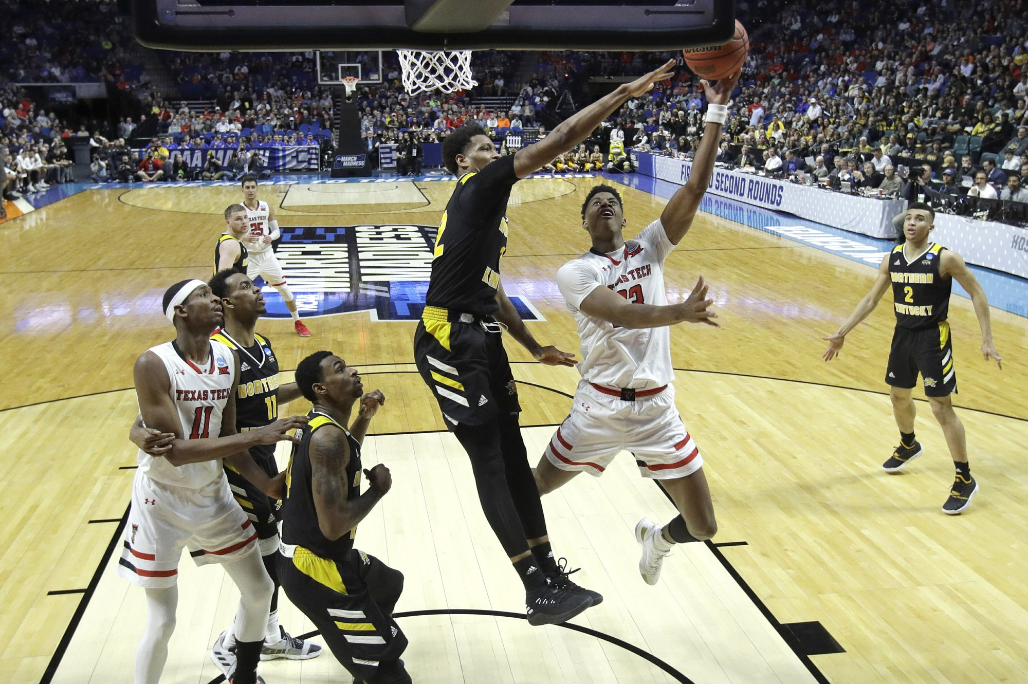 Texas Tech's Jarrett Culver puts up a shot under pressure from Northern Kentucky's Dantez Walton during the second half of a first-round men's college basketball game in the NCAA Tournament Friday, March 22, 2019, in Tulsa, Okla. Texas Tech won 72-57. (AP Photo/Charlie Riedel)