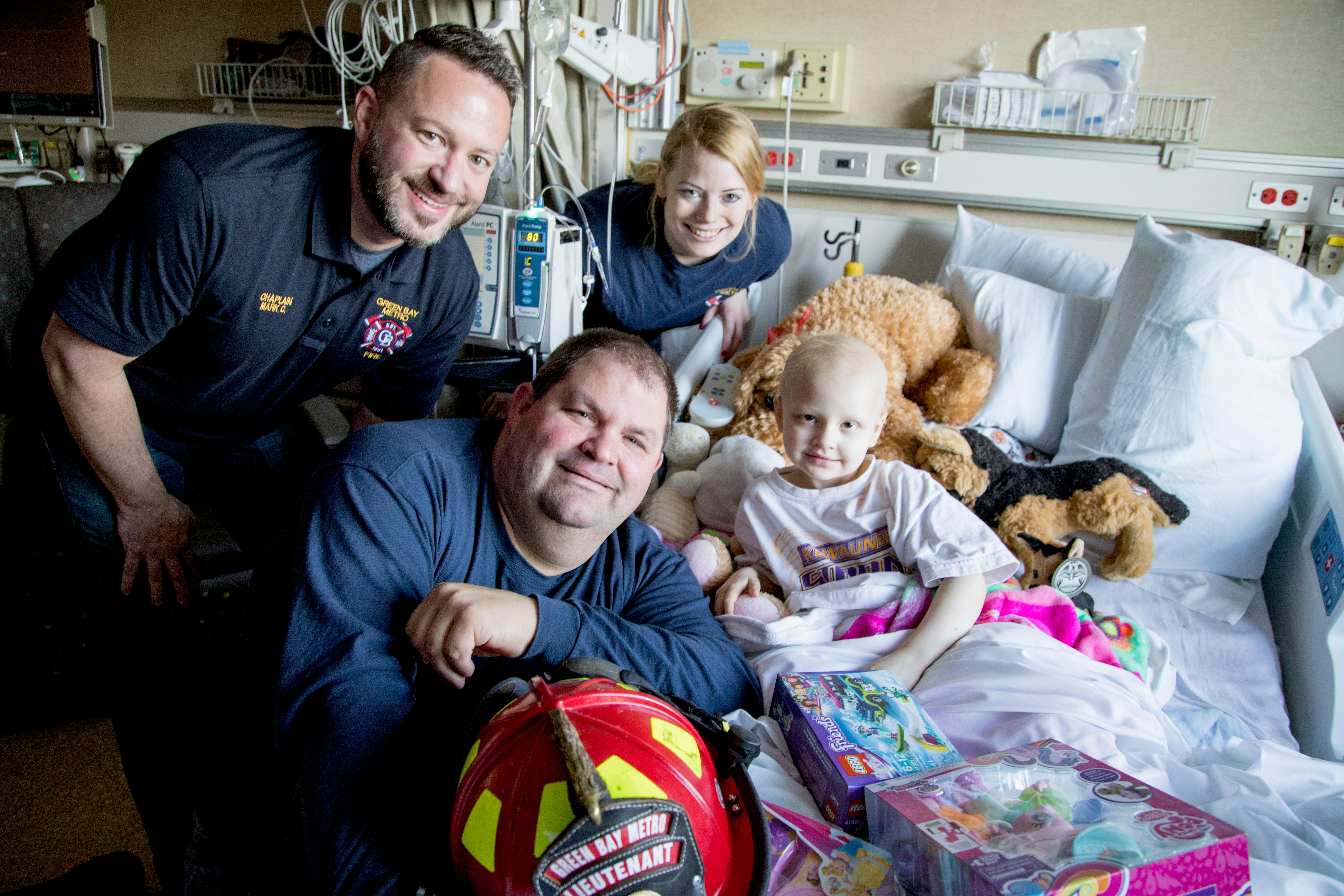 Green Bay firefighters delivered Christmas gifts to children at the HSHS St. Vincent Children's Hospital in Green Bay, December 19, 2017. (Photo courtesy of HSHS St. Vincent Children's Hospital)