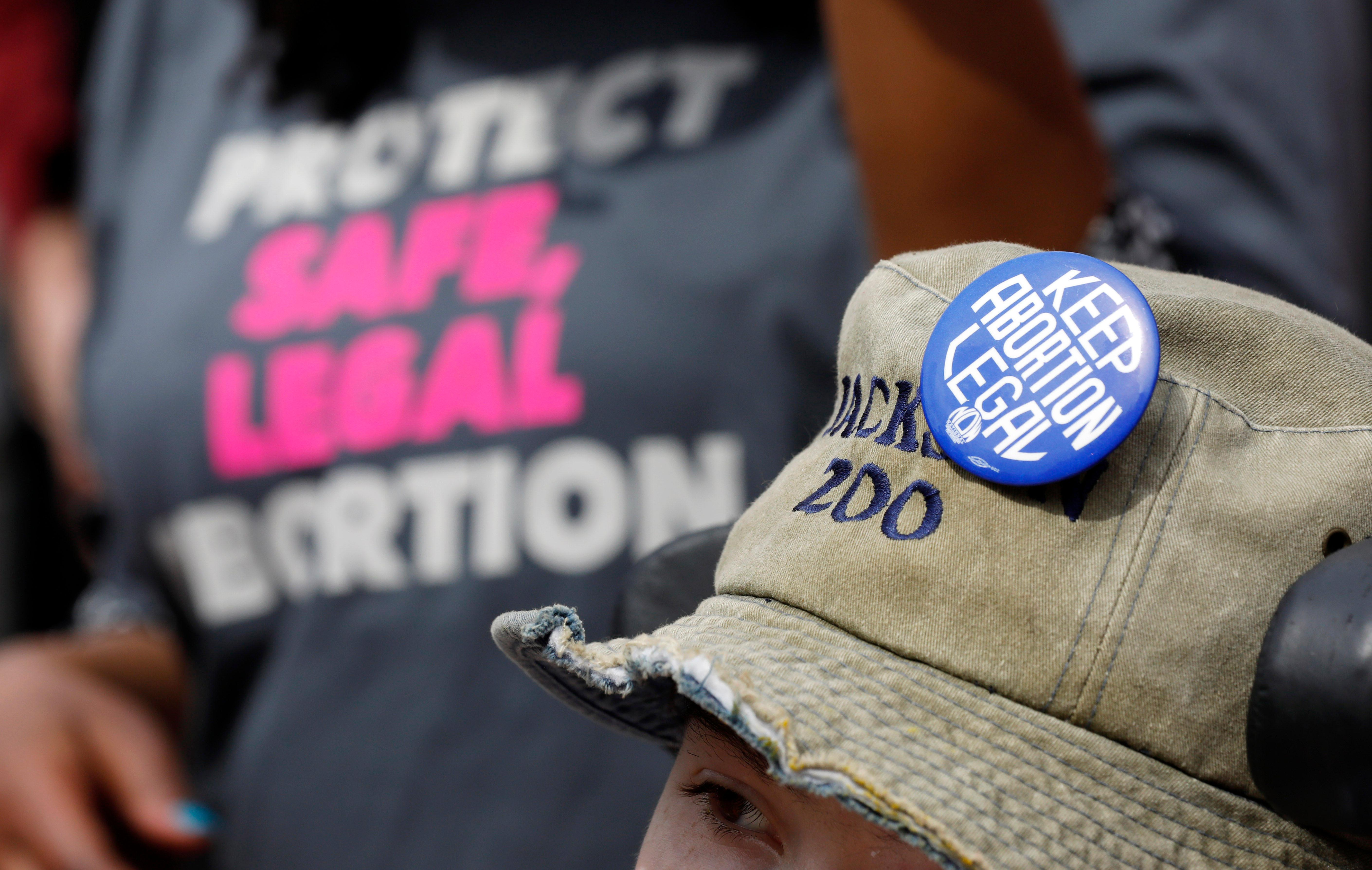 FILE -  In this March 14, 2019 file photograph, a Planned Parenthood supporter hosts an abortion rights button on her hat during a rally on the steps of the Capitol in Jackson, Miss. On Tuesday, March 19.. (AP Photo/Rogelio V. Solis, File)
