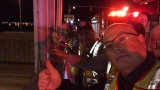 Fire trucks on I-95 overpasses salute vets on Honor Flight