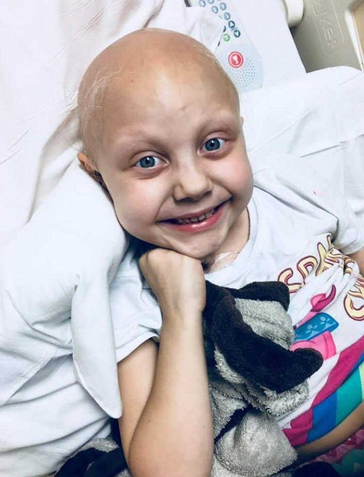 Throughout this long journey, Kaylee has never lost her contagious smile.{ }