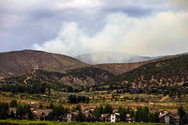 In this photo taken July 8, 2018, smoke rises from the Red Canyon Fire near Edwards, Colo. (Chris Dillmann /Vail Daily via AP)