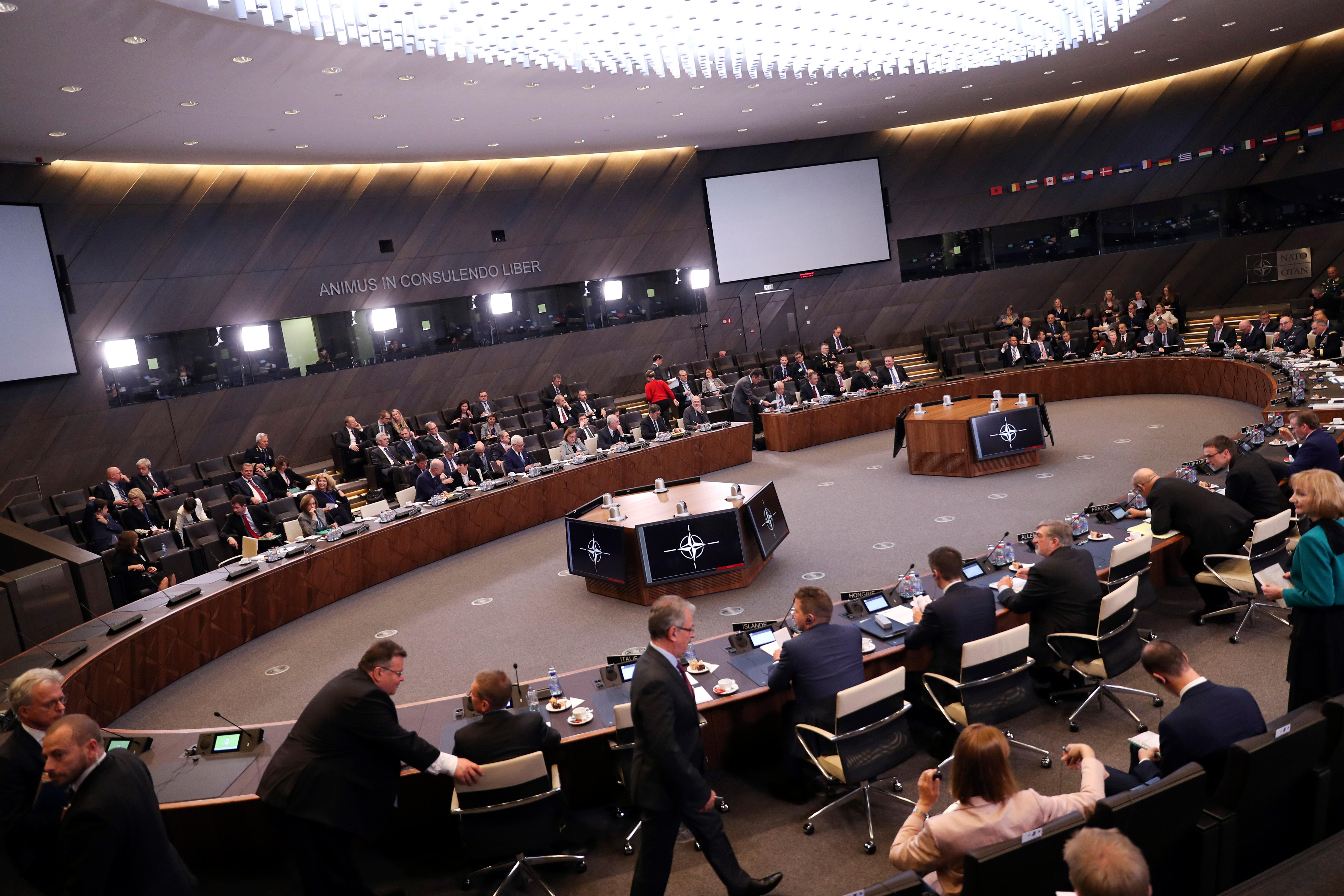 A general view of a meeting of the North Atlantic Council at NATO headquarters in Brussels, Tuesday, Dec. 4, 2018. Russia takes center-stage at NATO Tuesday, as allied foreign ministers meet to debate ways to dissuade Moscow from destabilizing Ukraine and respect a landmark Cold-war era nuclear treaty. (AP Photo/Francisco Seco)