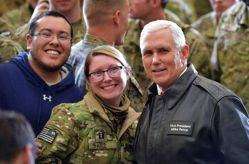 U.S. Vice President Mike Pence poses for a photo in a hangar at Bagram Air Base in Afghanistan on Thursday, Dec. 21, 2017. Mandel Ngan/Pool via AP)