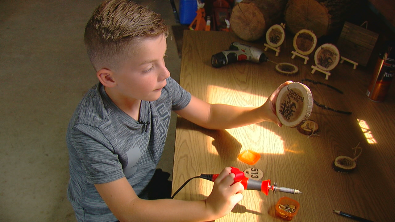 Young 8-year-old entrepreneur markets wood-burned coasters to local brewery (WKRC)