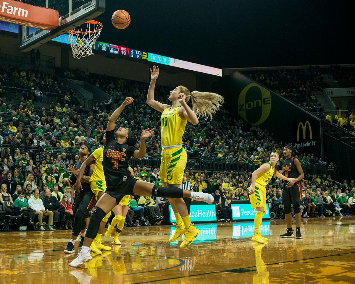 Oregon Ducks Anneli Malay (#15) attempts to make a field goal. The Oregon Ducks defeated the USC Trojans 80-74 on Friday at Matthew Knight Arena in a game that went into double overtime. Lexi Bando sealed the Ducks' victory by scoring a three-pointer in the closing of the game. Ruthy Hebard set a new NCAA record of 30 consecutive field goals in three straight games, the old record being 28. Ruthy Hebard got a double-double with 27 points and 10 rebounds, Mallory McGwire also had 10 rebounds. The Ducks had four players in double digits. The Ducks are now 24-4, 13-2 in the Pac-12, and are tied for first with Stanford. Photo By Rhianna Gelhart, Oregon News Lab