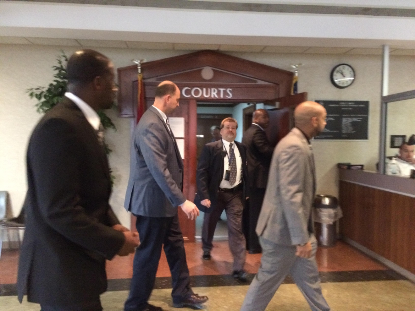Ooltewah High School assistant basketball coach Karl Williams (left), Athletic Director Jesse Nayadley (center) and head coach Andre Montgomery (right) leave court after their preliminary hearing on February 15th.
