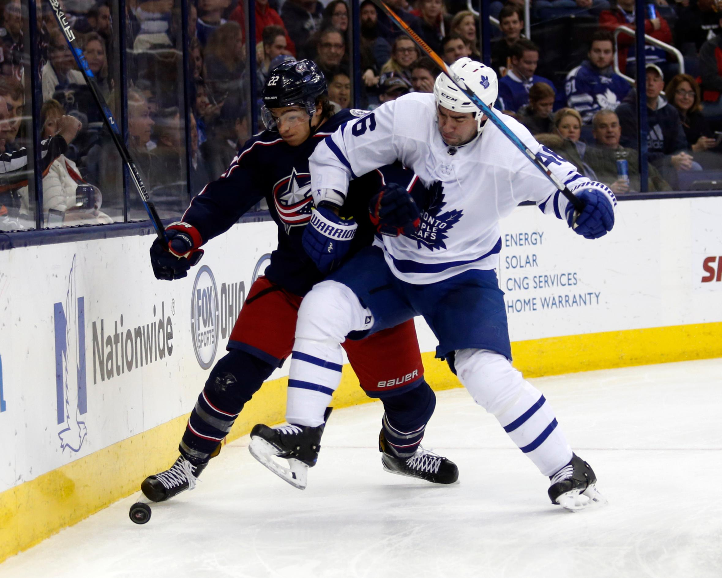 Toronto Maple Leafs defenseman Roman Polak, right, of the Czech Republic, collides with Columbus Blue Jackets forward Sonny Milano during the second of an NHL hockey game in Columbus, Ohio, Wednesday, Dec. 20, 2017. (AP Photo/Paul Vernon)