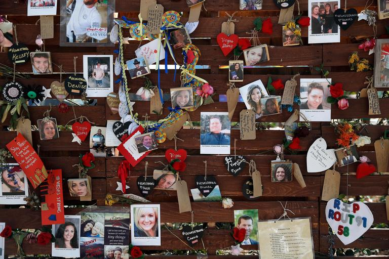 FILE-In this Oct. 16, 2017, file photo,,photos and notes adorn a wall at the Las Vegas Community Healing Garden in Las Vegas. The garden was built as a memorial for the victims of the recent mass shooting in Las Vegas. Two Nevada judges in Las Vegas have ordered the release of search warrant records and autopsy reports related to the deadliest mass shooting in modern U.S. history, with some information redacted. (AP Photo/John Locher, file)