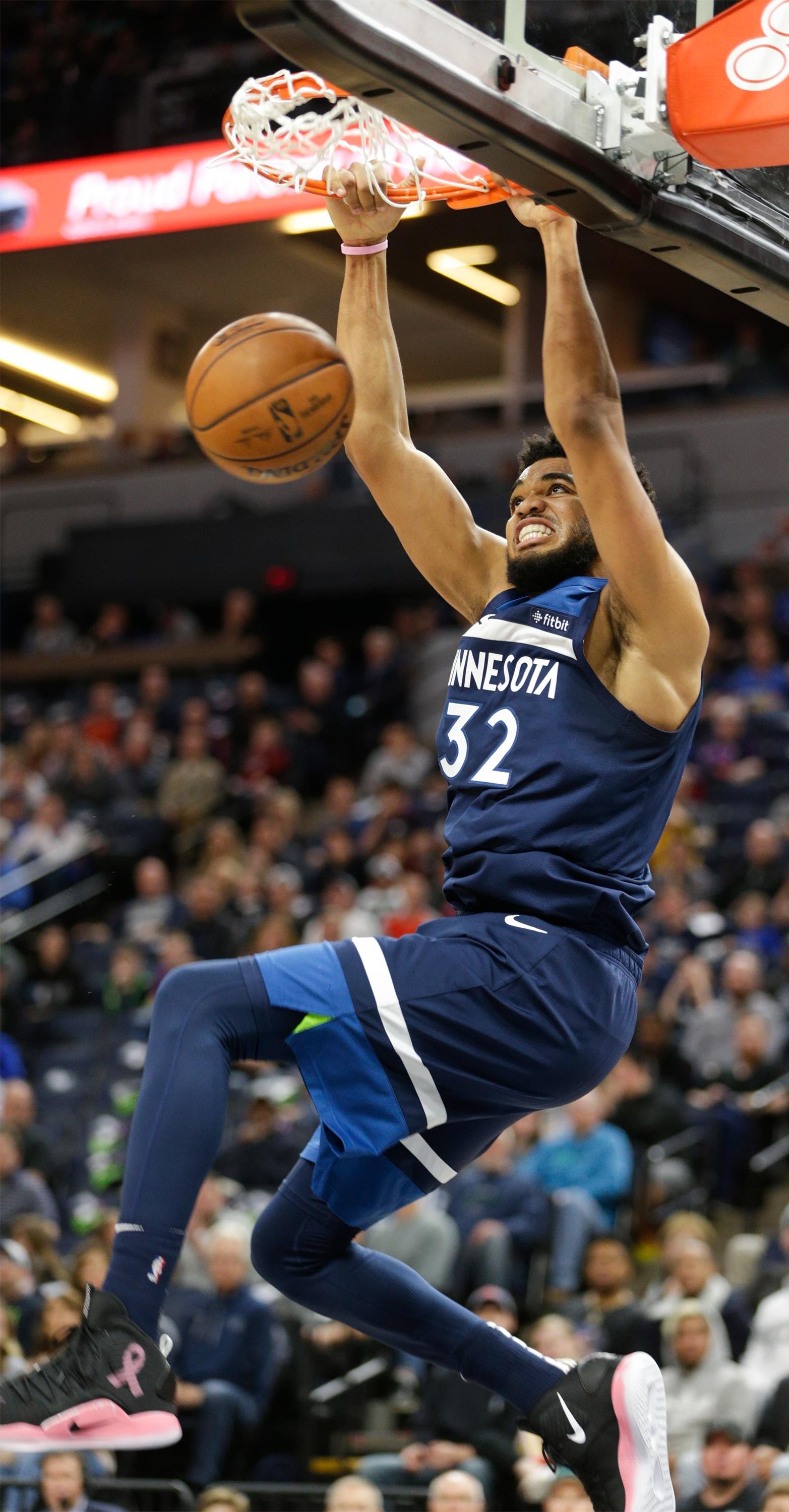 Minnesota Timberwolves center Karl-Anthony Towns (32) dunks during the first half of a NBA basketball game against the Oklahoma City Thunder Sunday, April 7, 2019, in Minneapolis. Towns finished with a game-high 53 points as Oklahoma won 132-126. (AP Photo/Paul Battaglia)