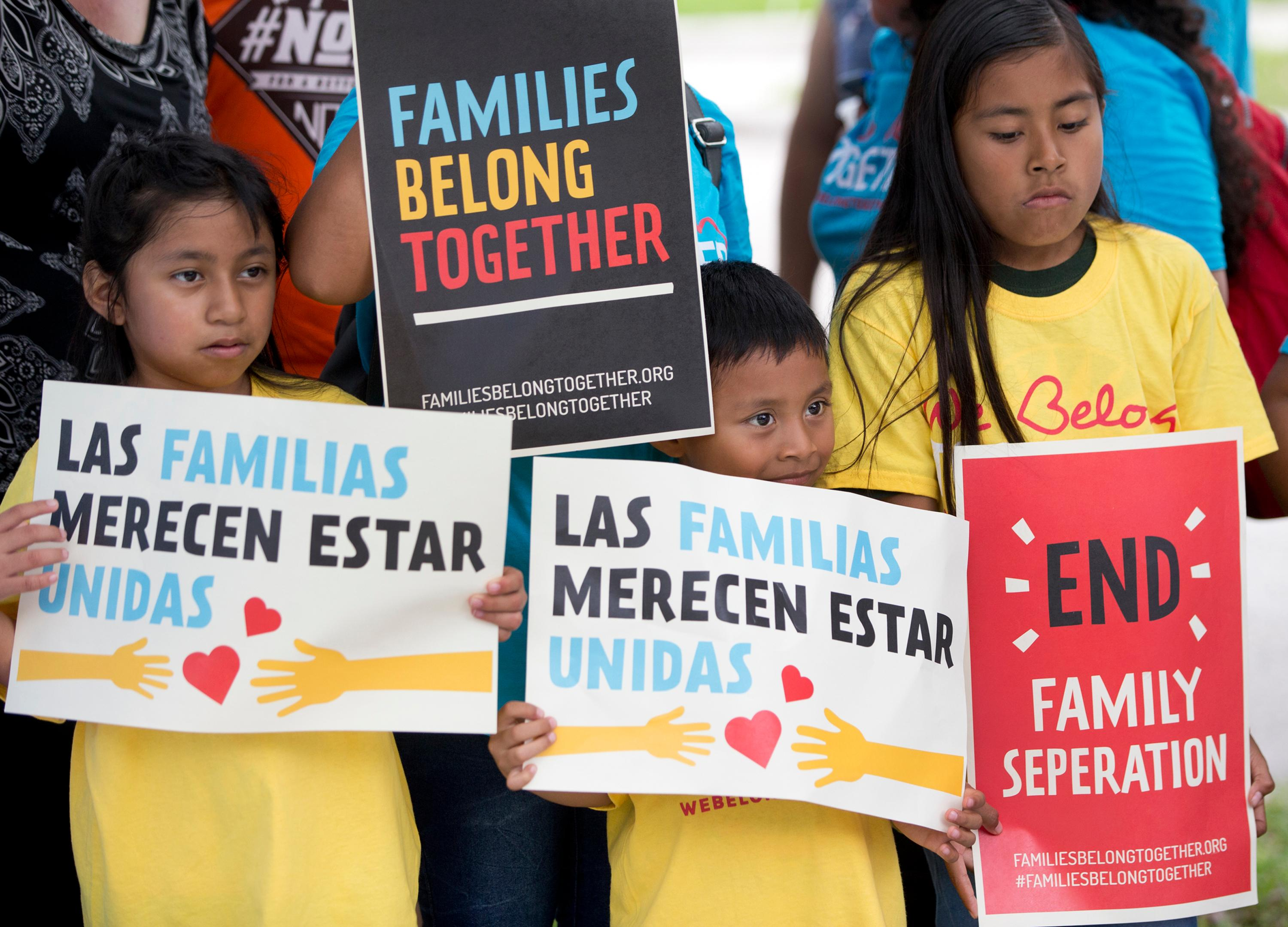 FILE - In this June 1, 2018, file photo, children hold signs during a demonstration in front of the Immigration and Customs Enforcement offices in Miramar, Fla. The Trump administration's move to separate immigrant parents from their children on the U.S.-Mexico border has turned into a full-blown crisis in recent weeks, drawing denunciation from the United Nations, Roman Catholic bishops and countless humanitarian groups. (AP Photo/Wilfredo Lee, File)