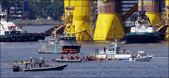Kayaktivists protest in the water near a Shell Oil rig parked in the Port of Seattle. (KOMO Photo)