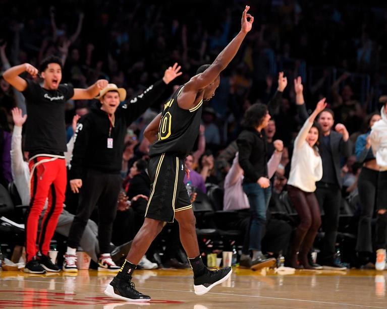 Los Angeles Lakers guard Andre Ingram celebrates after making a 3-point shot during the second half of the team's NBA basketball game against the Houston Rockets on Tuesday, April 10, 2018, in Los Angeles. The Rockets won 105-99. (AP Photo/Mark J. Terrill)