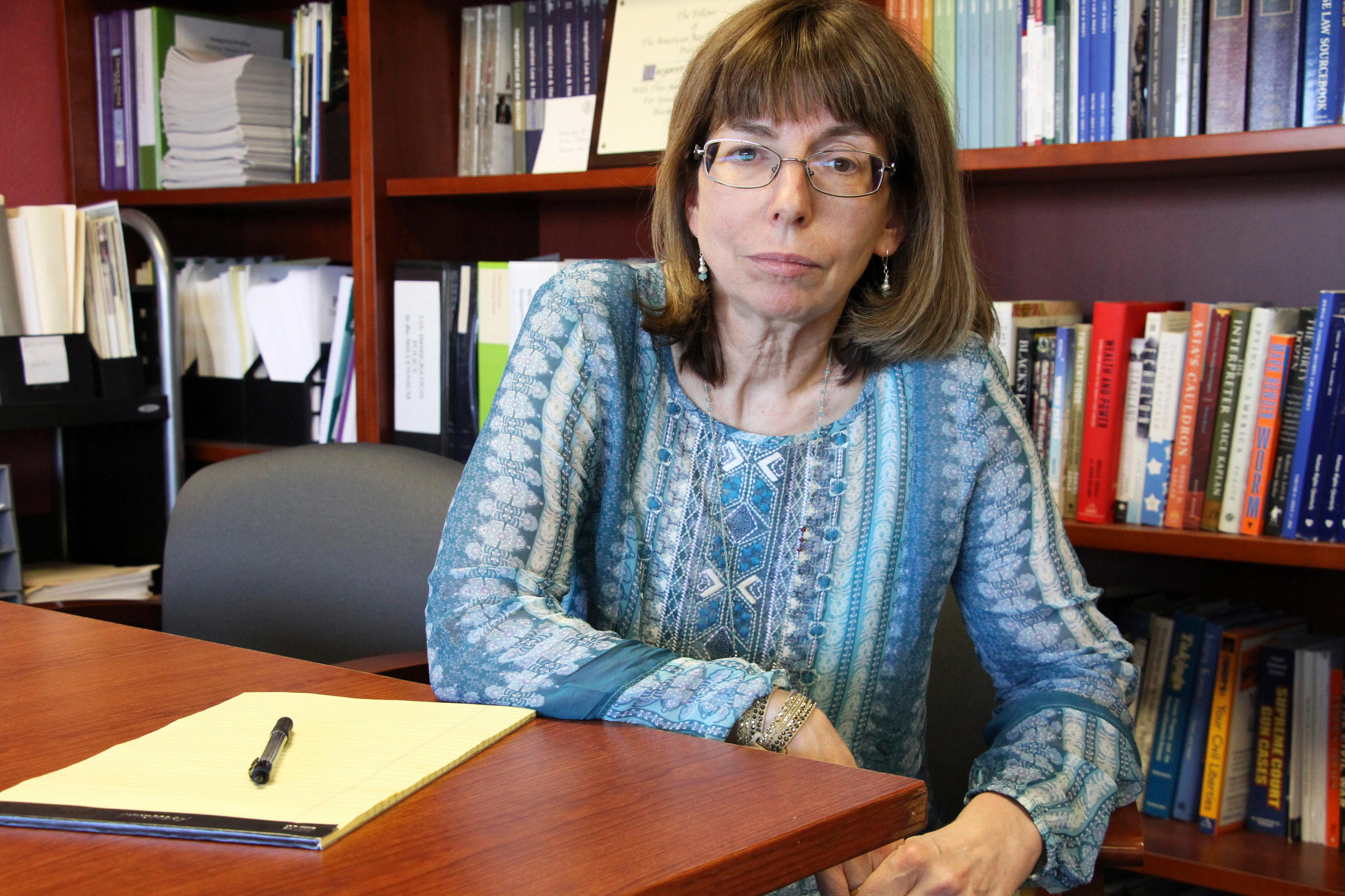 In this Tuesday, July 3, 2018 photo, Margaret Stock, an Alaska-based immigration attorney and a retired Army Reserve lieutenant colonel who helped create the immigrant recruitment program, poses at her office in Anchorage, Alaska. The U.S. Army has moved in recent weeks to discharge some immigrant recruits and reservists who enlisted through a program that promised them a path to citizenship. Stock said she's been inundated over the past several days by recruits who report being abruptly discharged. (AP Photo/Mark Thiessen)