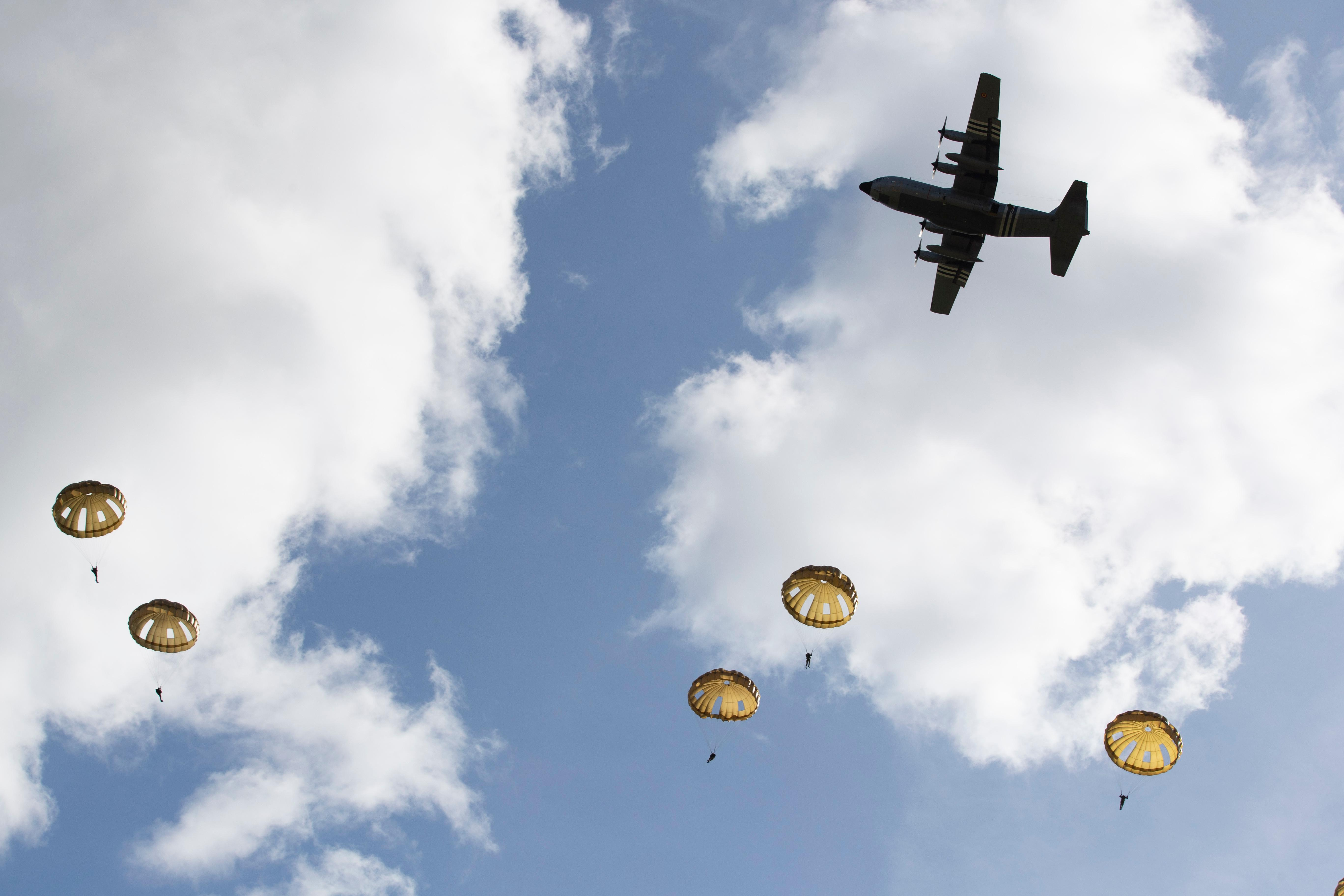 Parachutist jump from a plane near Groesbeek, Netherlands, Thursday, Sept. 19, 2019, as part of commemorations marking the 75th anniversary of Operation Market Garden, an ultimately unsuccessful airborne and land offensive that Allied leaders hoped would bring a swift end to World War II by capturing key Dutch bridges and opening a path to Berlin. (AP Photo/Peter Dejong)