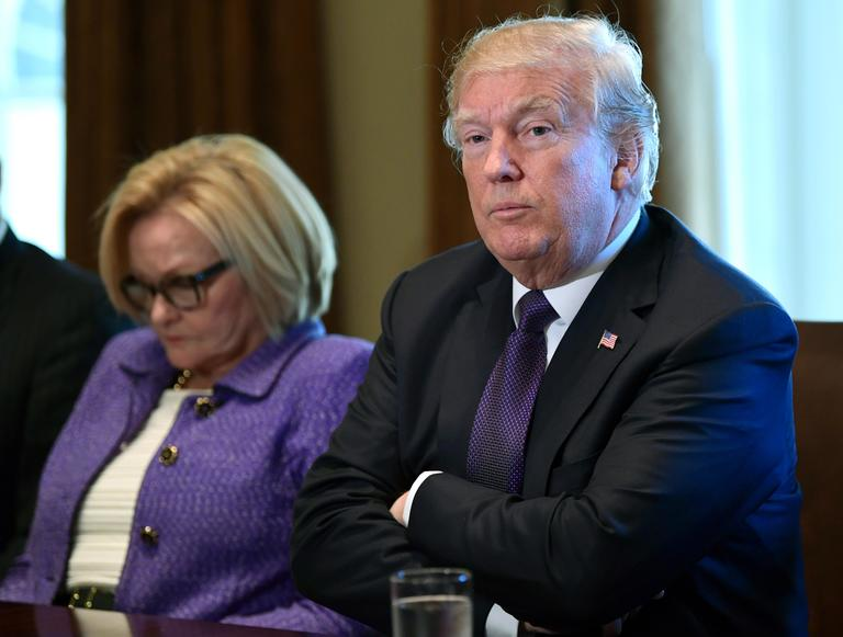 President Donald Trump, right, sitting next to Sen. Claire McCaskill, D-Mo., left, speaks during a meeting with members of the Senate Finance Committee and members of the President's economic team in the Cabinet Room of the White House in Washington, Wednesday, Oct. 18, 2017. (AP Photo/Susan Walsh)