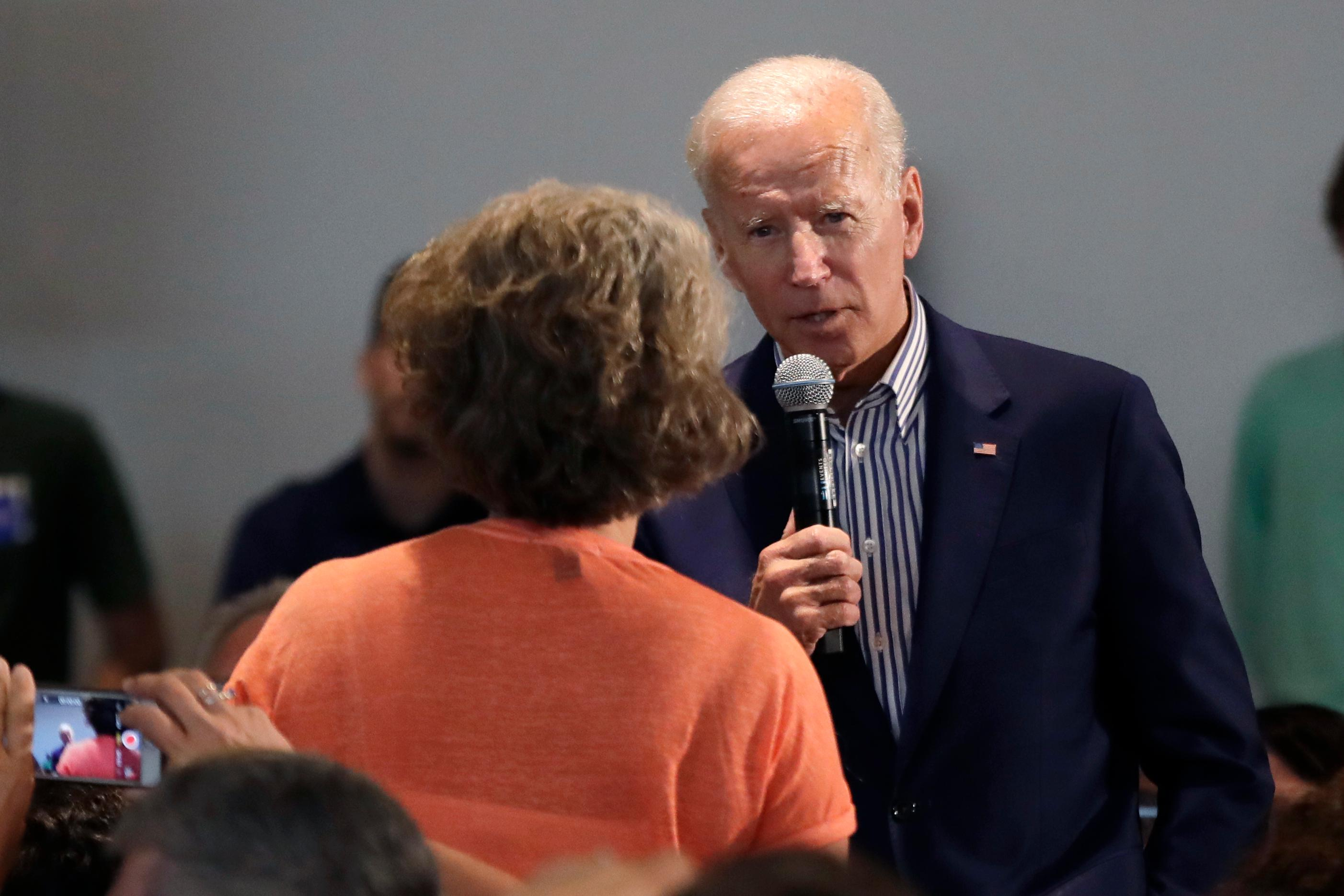 Democratic presidential candidate former Vice President Joe Biden answers a question from a woman in the audience during a campaign event at Dartmouth College, Friday, Aug. 23, 2019, in Hanover, N.H. (AP Photo/Elise Amendola)