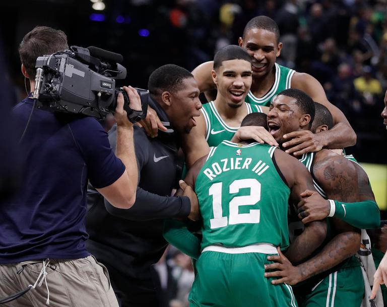 Boston Celtics' Terry Rozier (12) celebrates with teammates after they defeated the Indiana Pacers in an NBA basketball game, Monday, Dec. 18, 2017, in Indianapolis. (AP Photo/Darron Cummings)