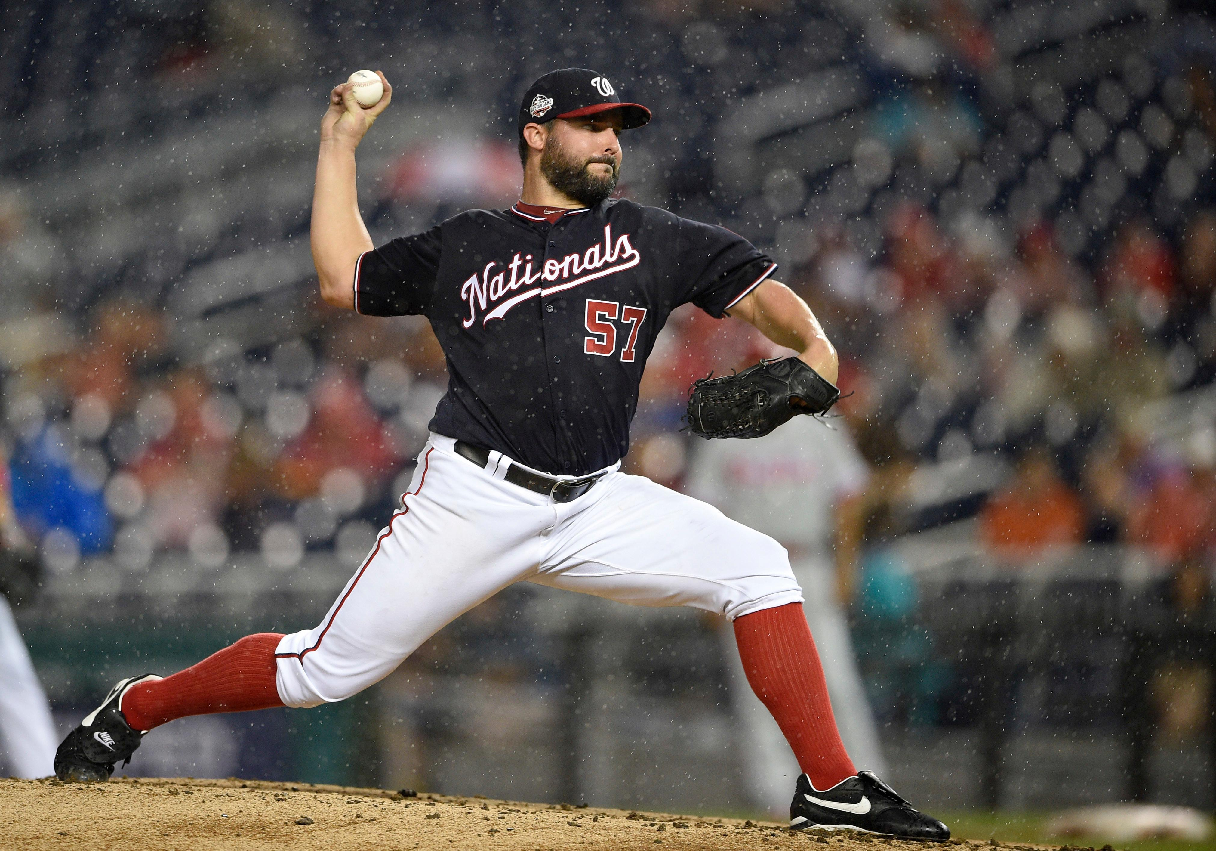 Washington Nationals starting pitcher Tanner Roark delivers a pitch during the third inning of a baseball game against the Philadelphia Phillies, Tuesday, Aug. 21, 2018, in Washington. (AP Photo/Nick Wass)