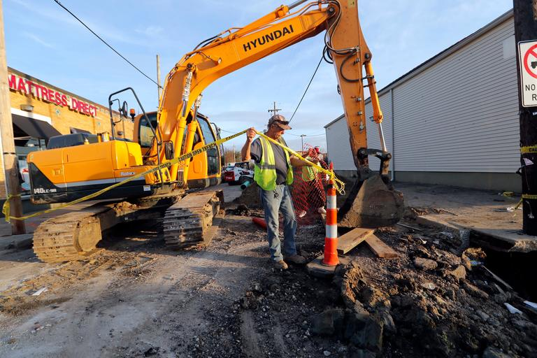 "Workers fix a sewer main below the sidewalk in Mid City New Orleans, Wednesday, Jan. 31, 2018.  The city of New Orleans is perhaps one of the best examples of what President Donald Trump calls the country's ""crumbling infrastructure."" City officials say New Orleans needs more than $11 billion to update key parts of its infrastructure. The city has about $2 billion in hand, but it's not clear that Trump's bold plan will help make up the gap. New Orleans' mayor says Trump's proposal puts the onus on cities and states to raise taxes and fees to pay for the improvements.  (AP Photo/Gerald Herbert)"