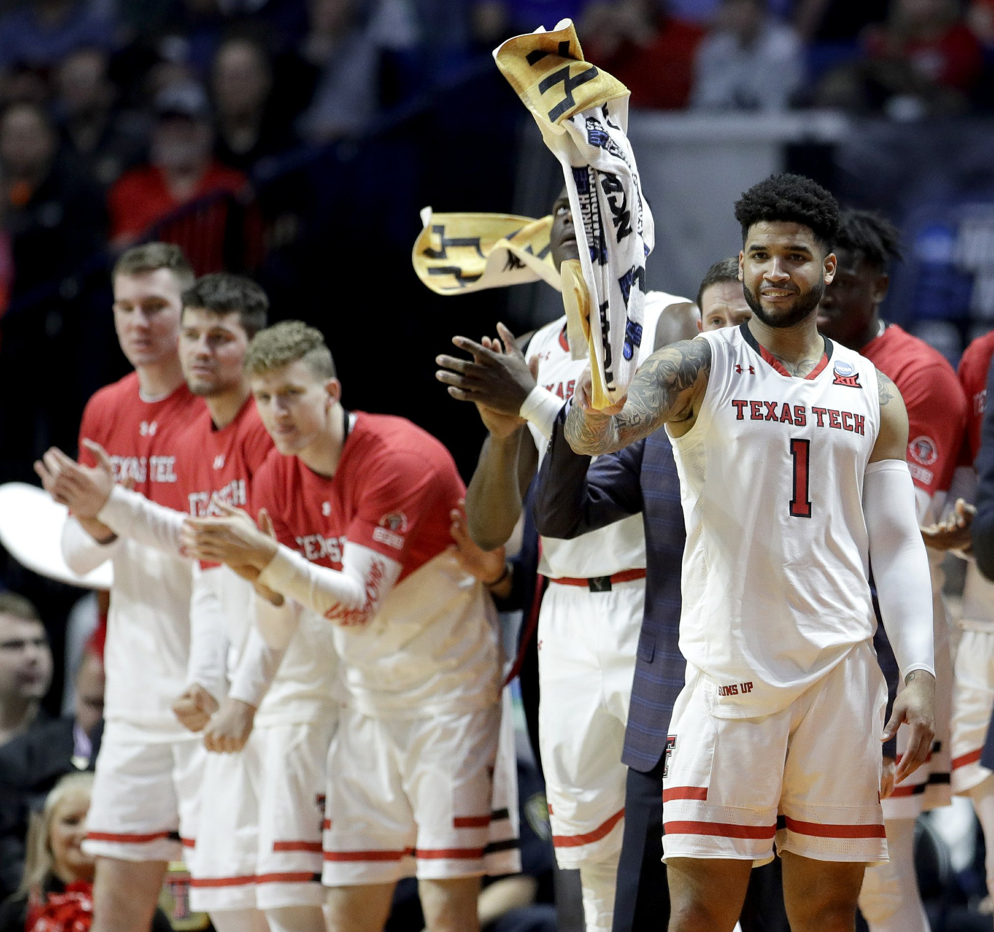 The Texas Tech bench celebrate after a basket during the second half of a first-round men's college basketball game against Northern Kentucky in the NCAA Tournament Friday, March 22, 2019, in Tulsa, Okla. Texas Tech won 72-57. (AP Photo/Charlie Riedel)