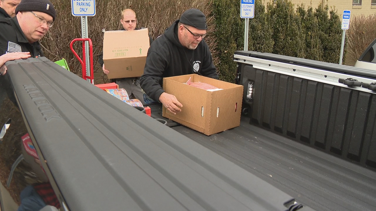 The food stock packed in boxes is kept in a storage room at the Black Mountain Police Department. Chief Shawn Freeman said the food boxes are typically delivered closer to Christmas. But this year, he thought the boxes with hams, canned goods and other food should be delivered to senior citizens early. (Photo credit: WLOS staff)