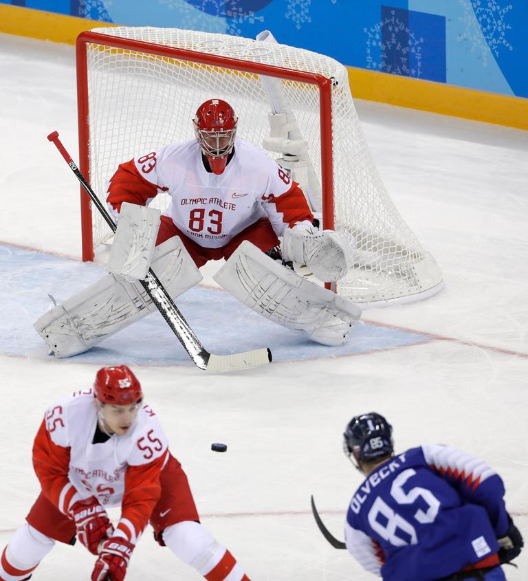 Peter Olvecky (85), of Slovakia, shoots a goal against Russian athlete Vasili Koshechkin (83) during the first period of the preliminary round of the men's hockey game at the 2018 Winter Olympics in Gangneung, South Korea, Wednesday, Feb. 14, 2018. (AP Photo/Matt Slocum)