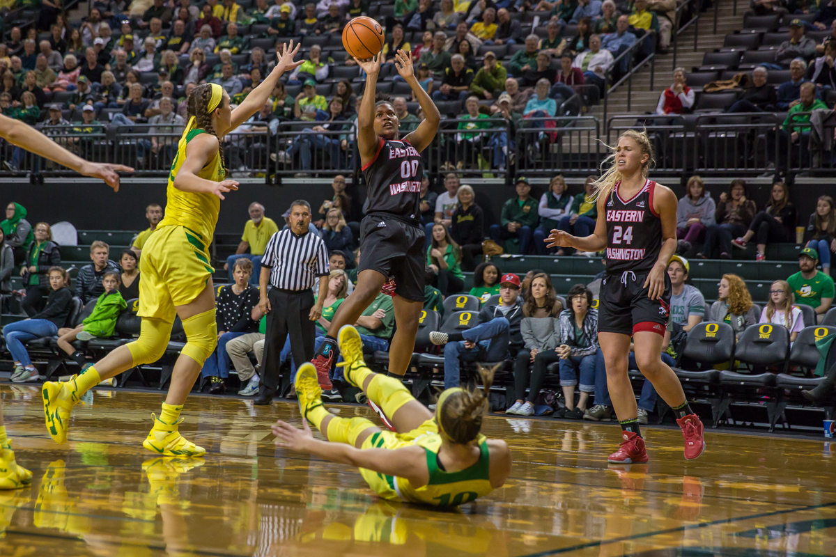 Eastern Washington forward Lily Perkins (#00) shoots the ball after knocking over Oregon guard Lexi Bando (#10). The Oregon Ducks women's basketball team beat the Eastern Washington Eagles 81-40 Tuesday night. Ruthy Hebard led the Ducks with 22 points. Oregon is now 4-1 on the season. Photo by Dillon Vibes