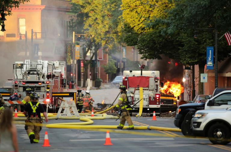 Firefighters work the scene of an explosion in downtown Sun Prairie, Tuesday, July 10, 2018. (Amber Arnold/Wisconsin State Journal via AP)