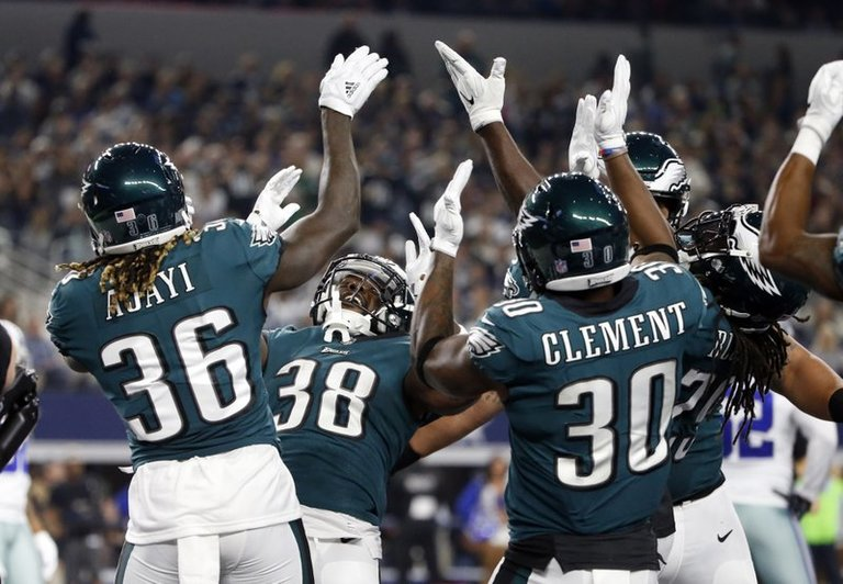 Eagles' Jay Ajayi (36), Kenjon Barner (38) and Corey Clement (30) along with others celebrate a touchdown by Barner in the first half of an NFL football game against the Dallas Cowboys on Sunday, Nov. 19, 2017, in Arlington, Texas. (AP Photo/Michael Ainsworth)