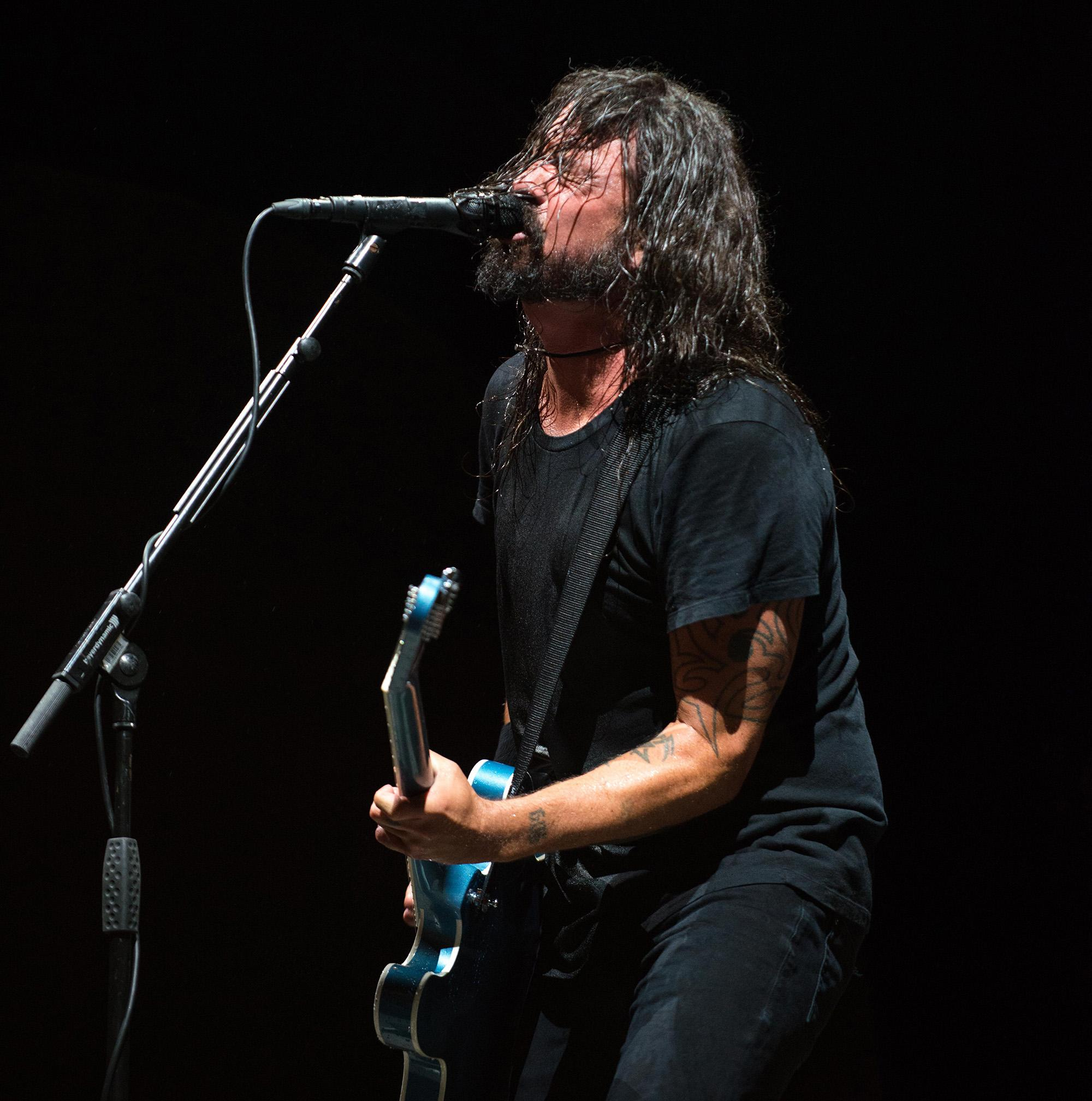 "Foo Fighters rocked the Moda Center on Monday night, playing hits that span their nearly two-decade career. The rockers are touring the globe in support of their latest album, ""Concrete and Gold."" The band recently postponed two Canadian stops after lead singer Dave Grohl lost his voice. (Photo by Tristan Fortsch on September 10, 2018)"
