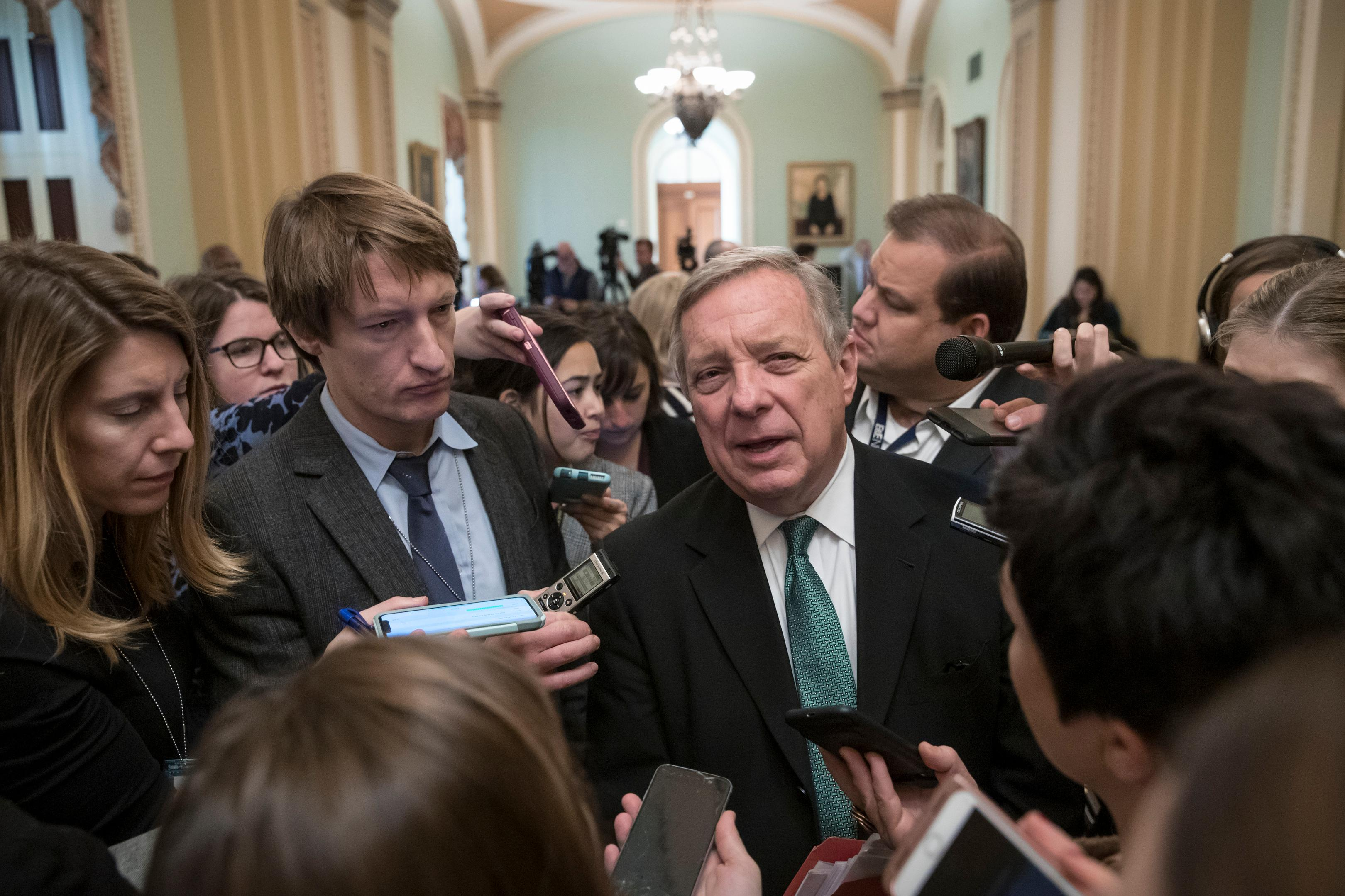 Sen. Dick Durbin, D-Ill., the assistant Democratic leader, is surrounded by reporters asking about the possibility of a partial government shutdown over the border wall funding, at the Capitol in Washington, Tuesday, Dec. 18, 2018. (AP Photo/J. Scott Applewhite)
