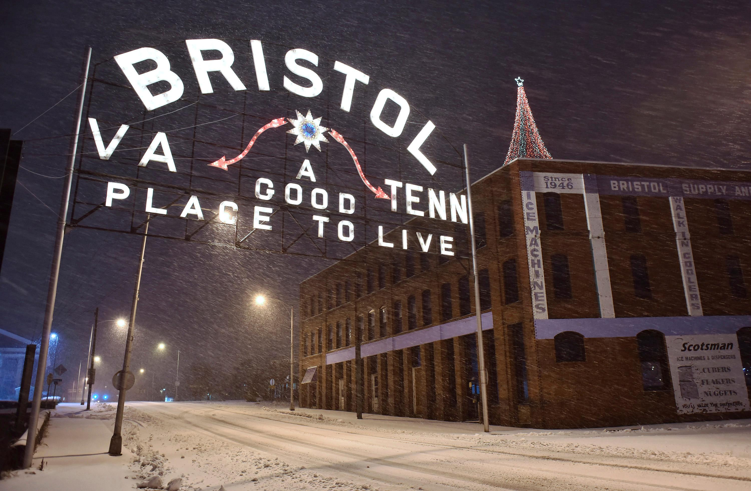 Snow falls in Bristol, Va., early Sunday, Dec. 9, 2018. A storm spreading snow, sleet and freezing rain across a wide swath of the South has millions of people in its path, raising the threat of immobilizing snowfalls, icy roads and possible power outages. (Andre Teague/The Bristol Herald-Courier via AP)